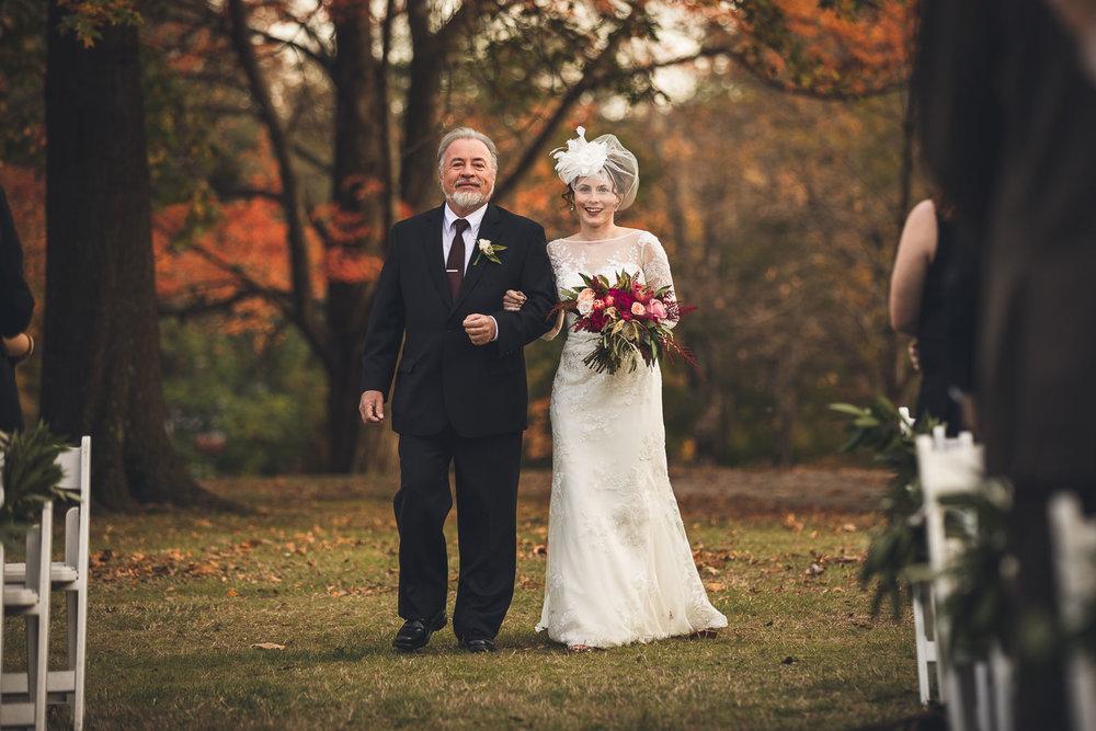 Father walks bride down aisle