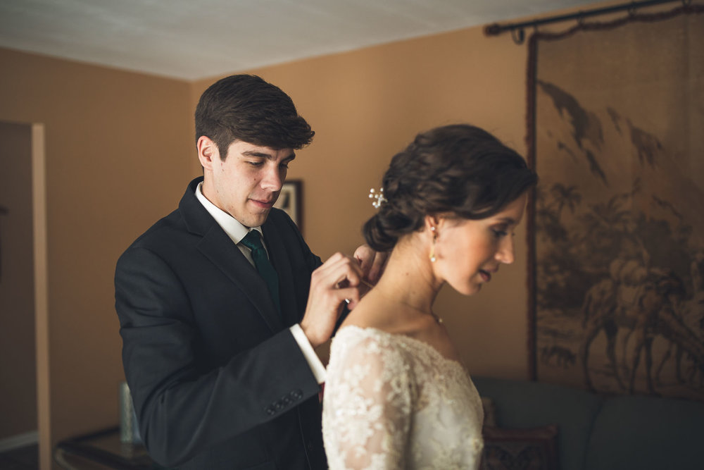 Brother helps Bride with Necklace