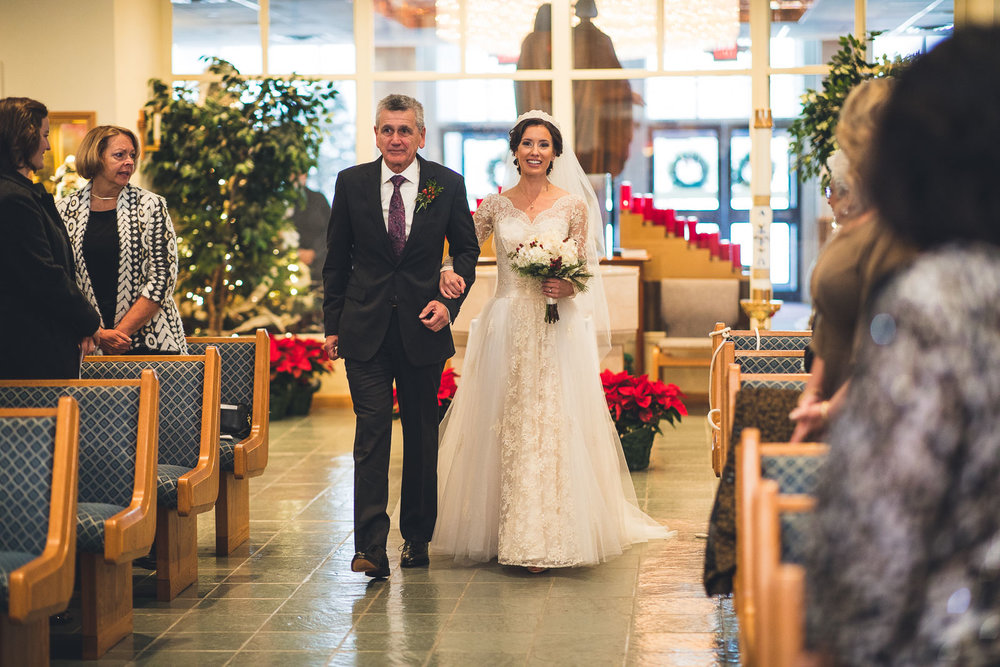Father walks bride down aisle
