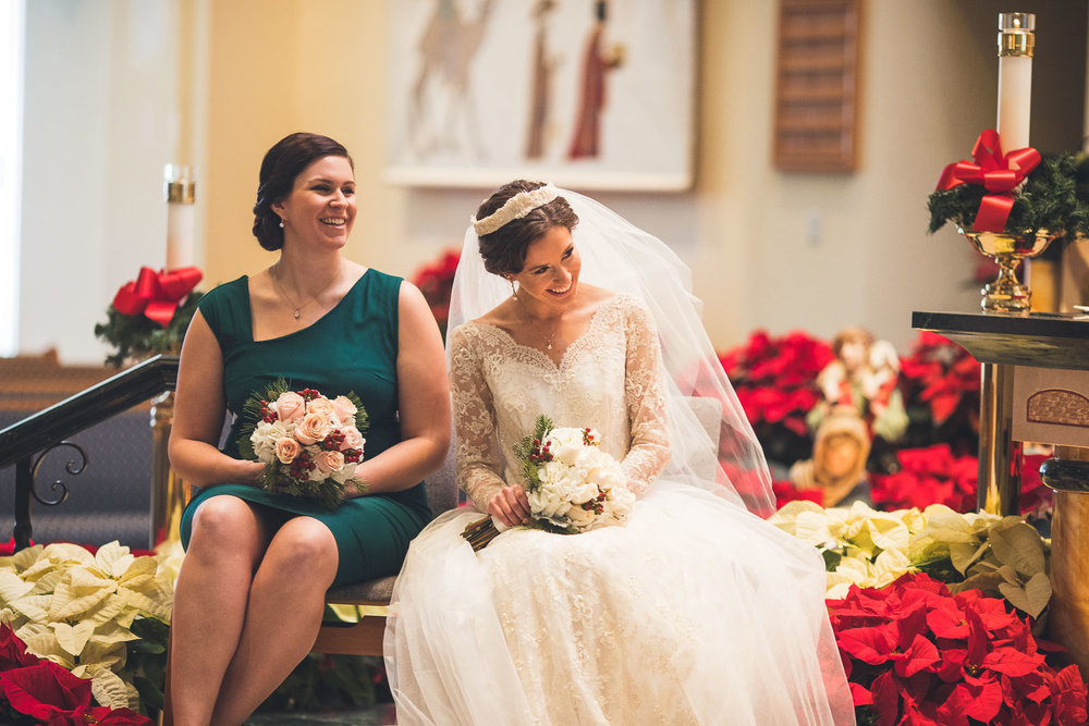 Bride laughs during ceremony Church of St. David the King