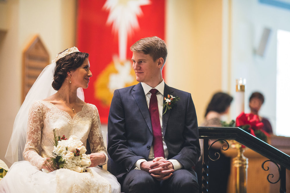 Couple smiles together during Wedding Ceremony