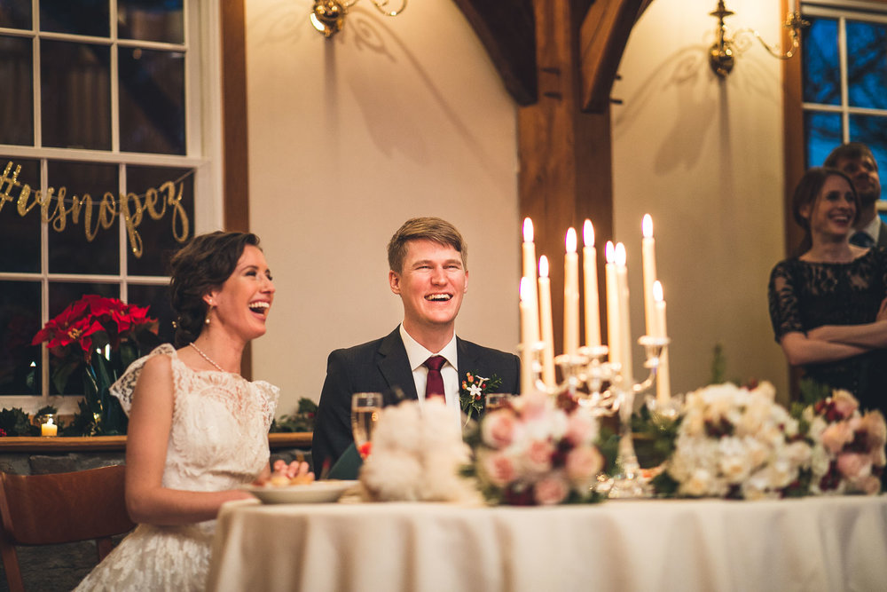 Couple laughs at wedding speech