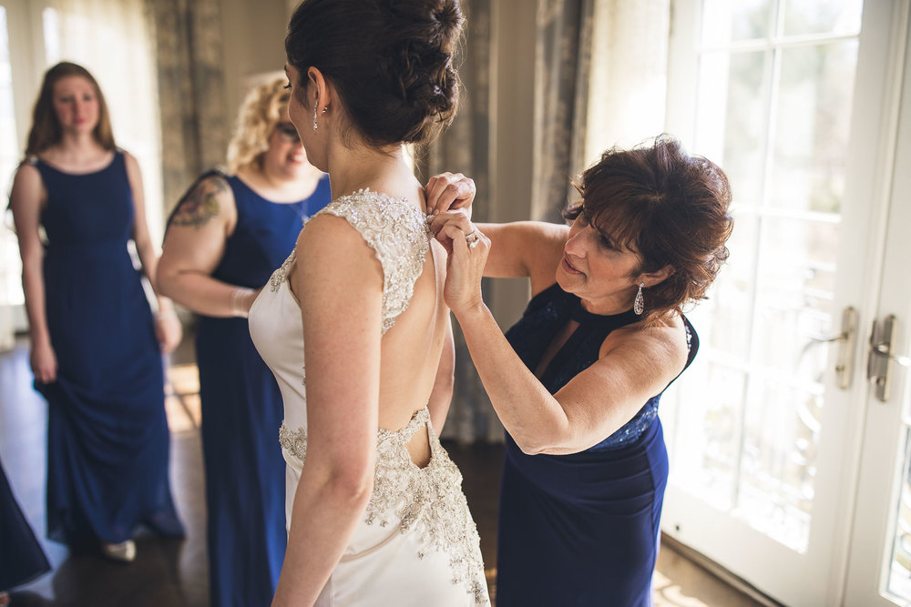 Mom helps with the finishing touches on the dress