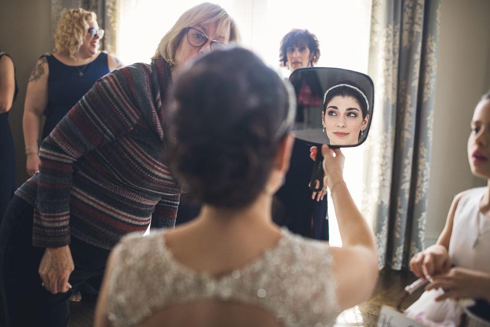 Bride checks hair