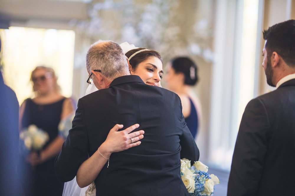 Father hugs Bride Wedding Ceremony
