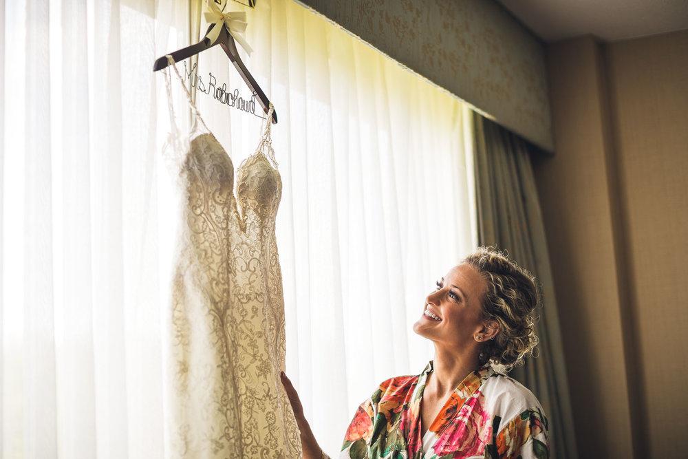 Bride admires dress