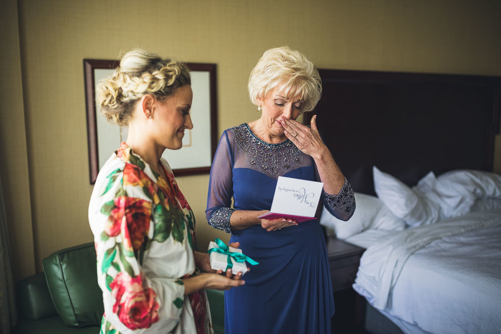 Bride gives gift to Mom