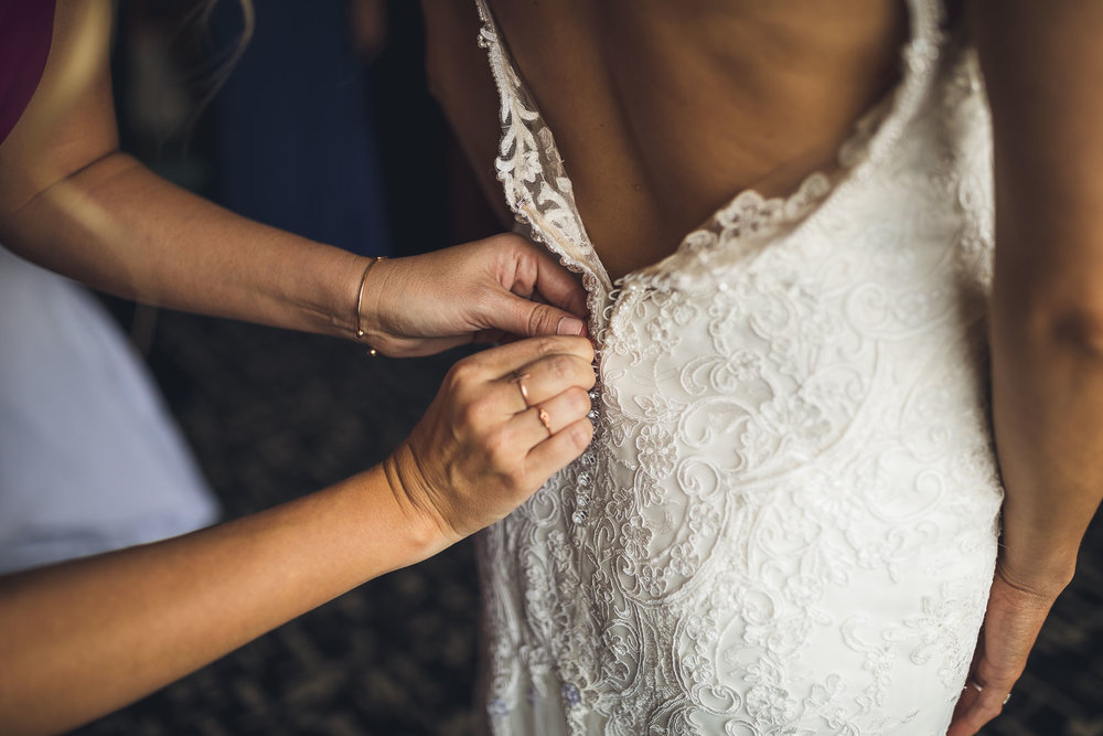 Bride gets dress on