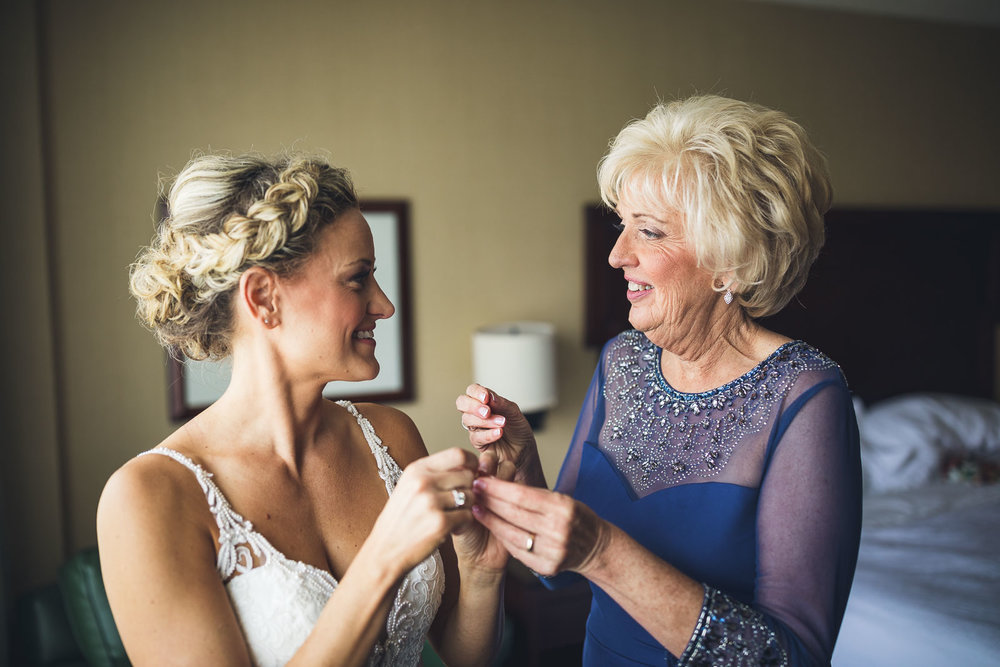 Mom Helps Bride with Dress