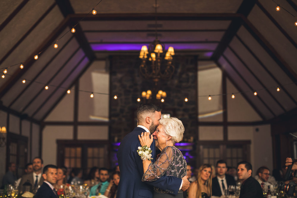 Groom dances with mother