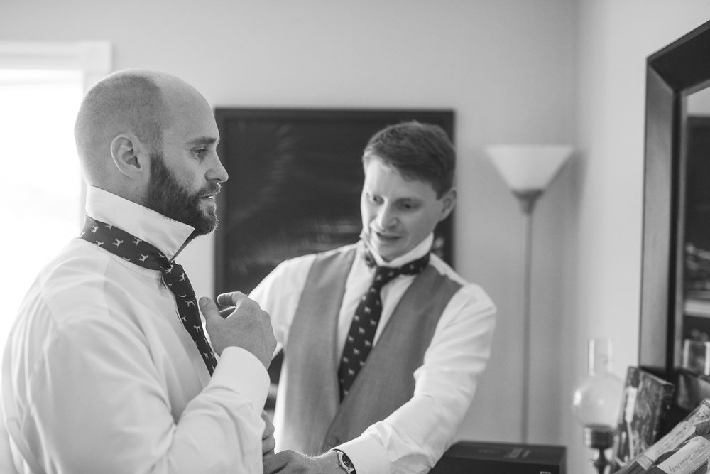 Best man helps with suit