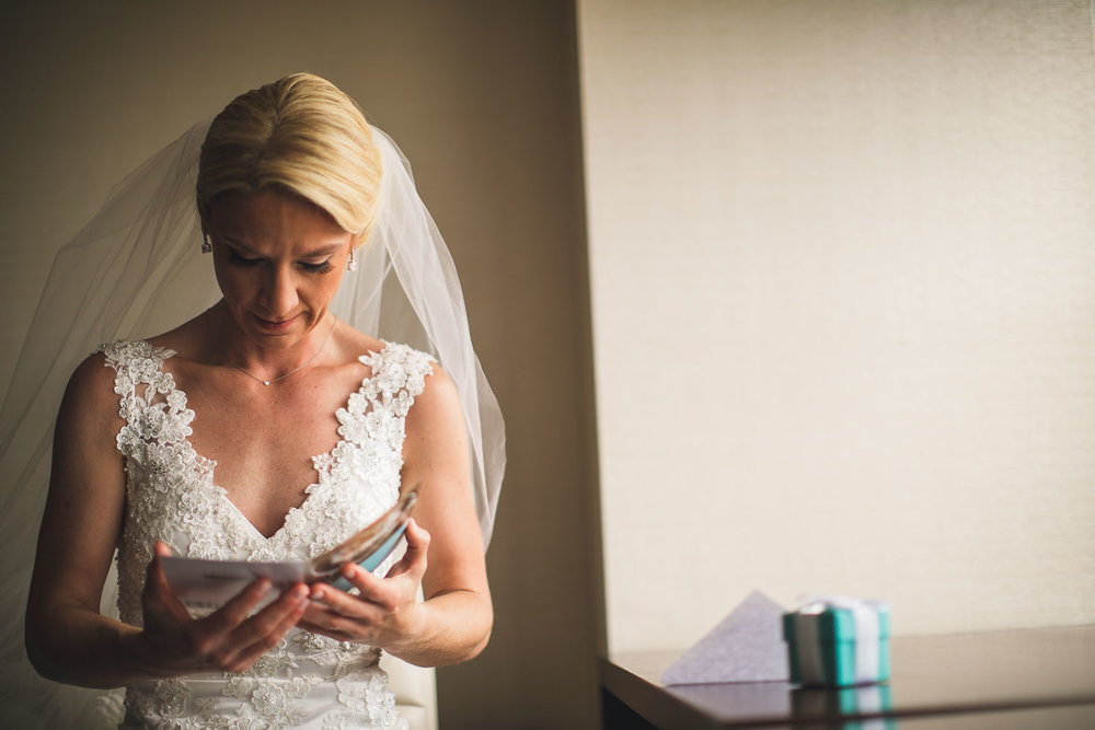 Bride reads card from Groom