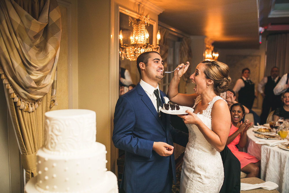 Groom enjoys some Cake