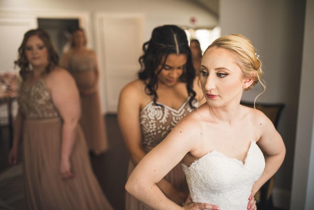Bride gets on dress