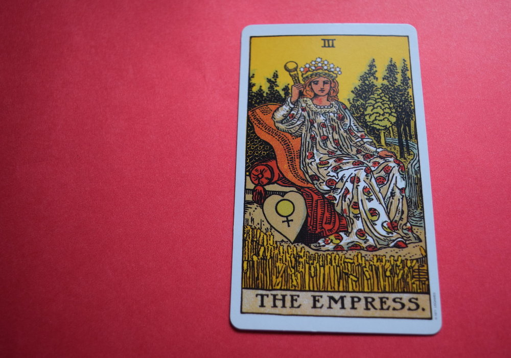 Article: Tipping And Psychic Mediums/Shamans/Healers - What's The Etiquette? Photo: The Empress Tarot Card from the Waite Deck on a Red Background by Amanda Linette Meder