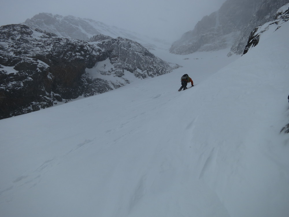 john breaking trail up the couloir. our bootpack was snowed- and winded-over by the time we were heading down.