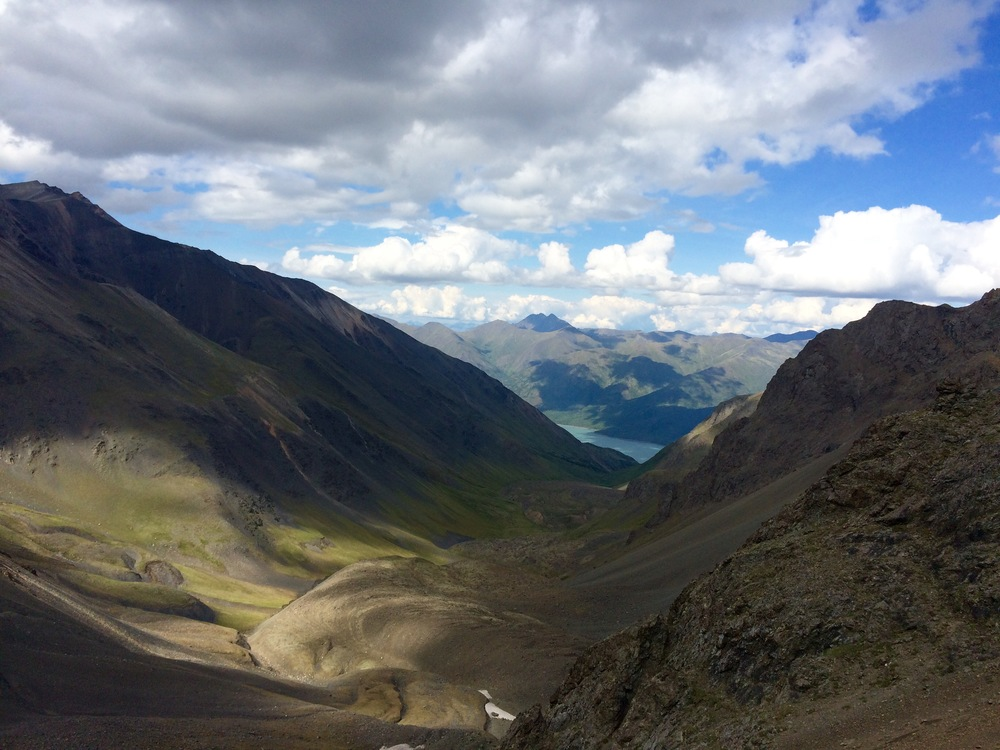 Looking down to Eklutna Lake. Lower in this valleywas some of my favorite walking: an idyllic creekbed, fields of wildflowers, and a bivy spot someone has obviously spent loads of time perfecting. Photo by K. Strong.