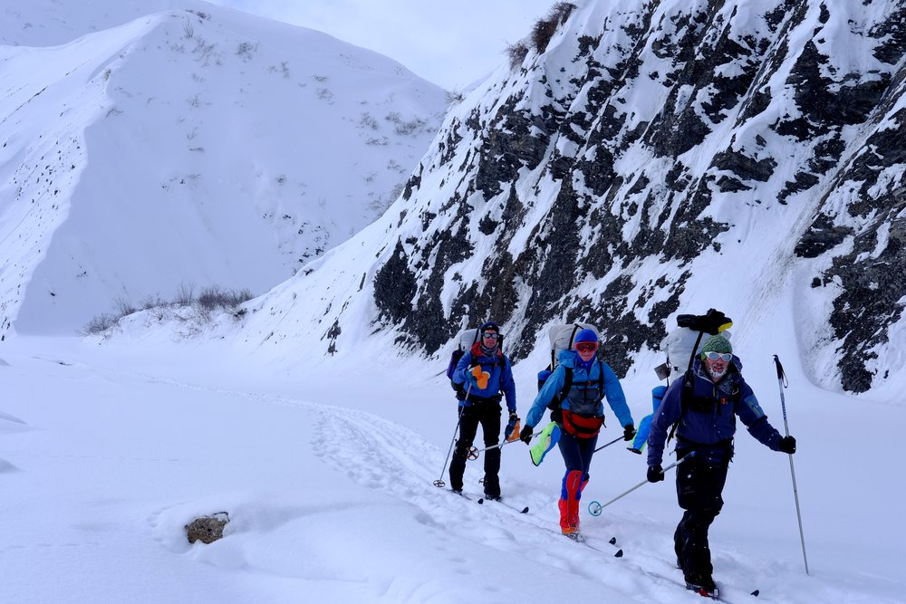 Chris Wrobel, Robin, and Doug Jewell ski through Atigun Gorge. Photo by K. Strong.