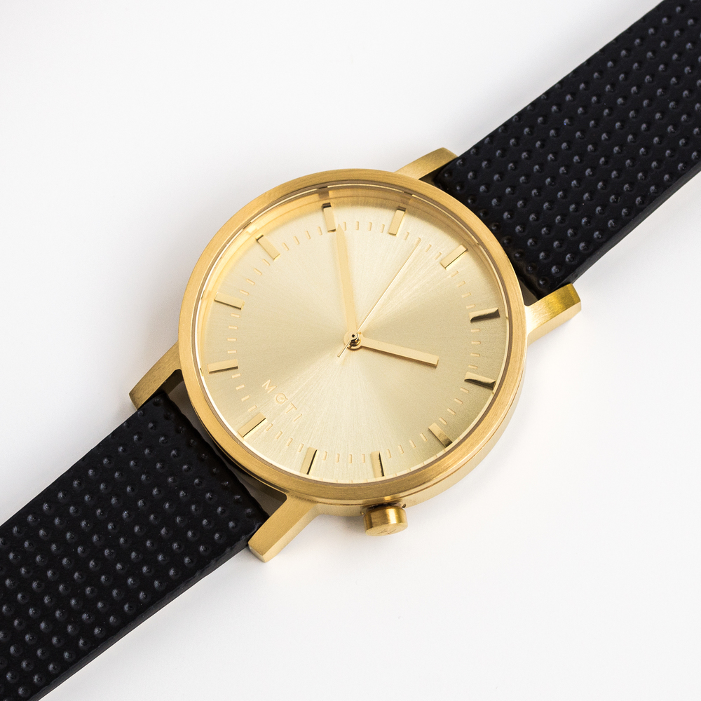 http://colabination.com/products/moti/gold-leather-minimal-watch