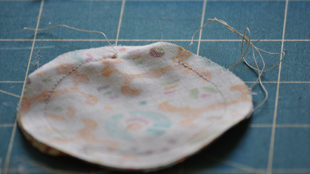 sew the two circles right sides together leaving an opening for turning right sides out.