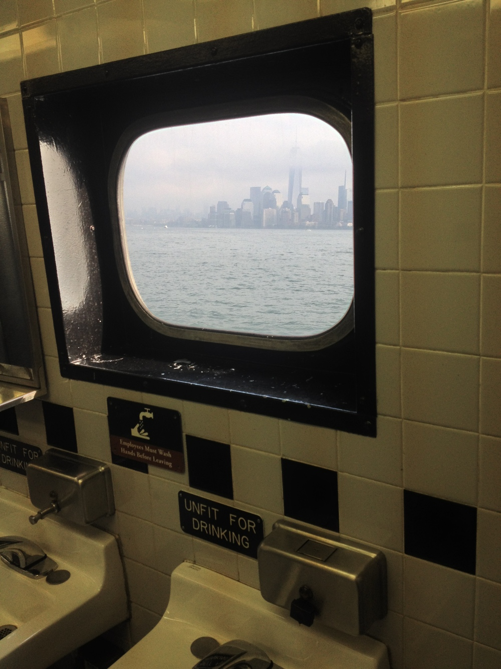 Continuing with my series on 'view from Men's room windows'. On the ferry to the Statue of Liberty.