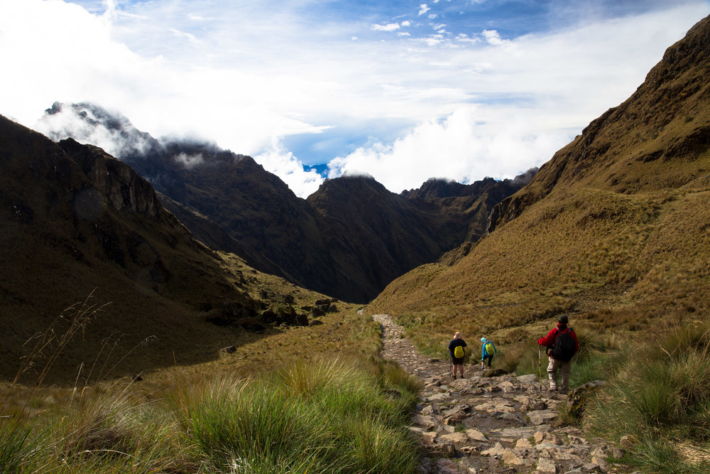 We begin the descent from Dead Woman's Pass. There is substantially less rainfall on this side of the mountain. Vegetation is mostly the highland grass visible here, food for deer and roofing material for Incas.