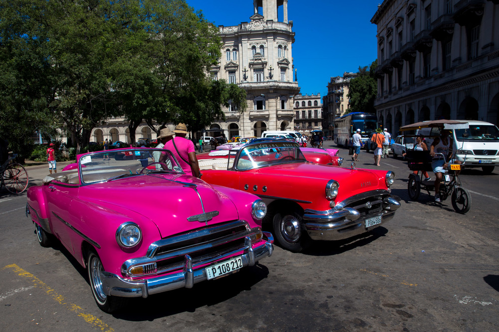 How could we resist a pink 1950s convertible? Turns out the 5000% price difference between a 'tourist convertible' and an old taxi (same sort of cars) made it easier than you might think.