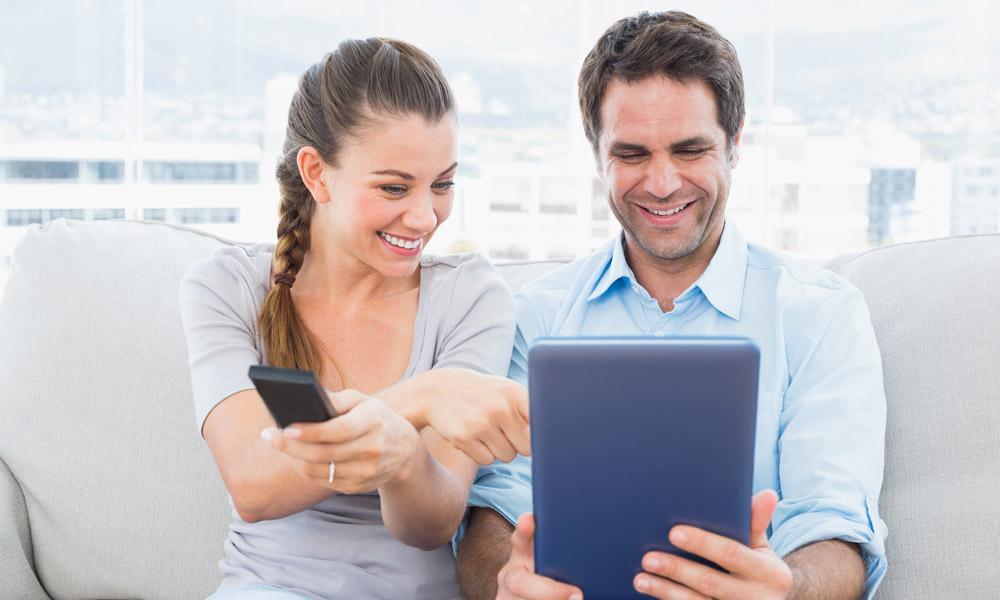 Couple looking at iPad