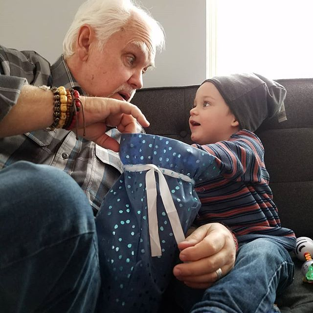 Few things beat the surprise and delight of opening presents with Grandpa.