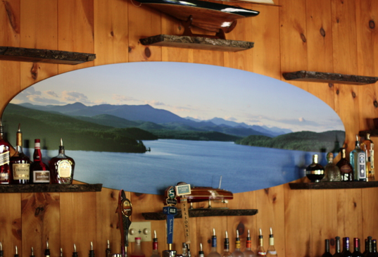 Photo by Carl Heilman of a view of Schroon Lake, featured behind the bar of Sticks and Stones on Route 9.