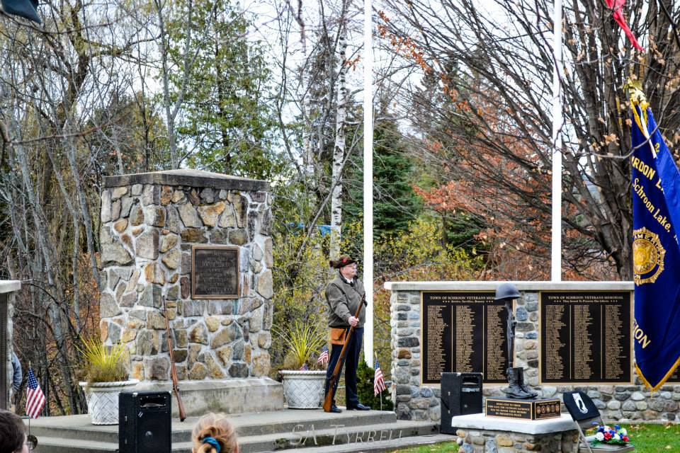 Photo Courtesy of Sharron Tyrrell. Veteran Dave Insull stands at attention during the Schroon Lake Veterans Day Ceremony