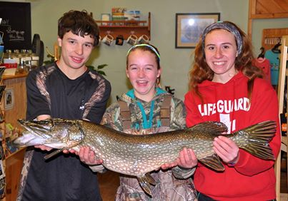 Photo courtesy The Crossroads: Colin, Sydney, and Kerrianne with a nice Northern Pike from Schroon Lake.