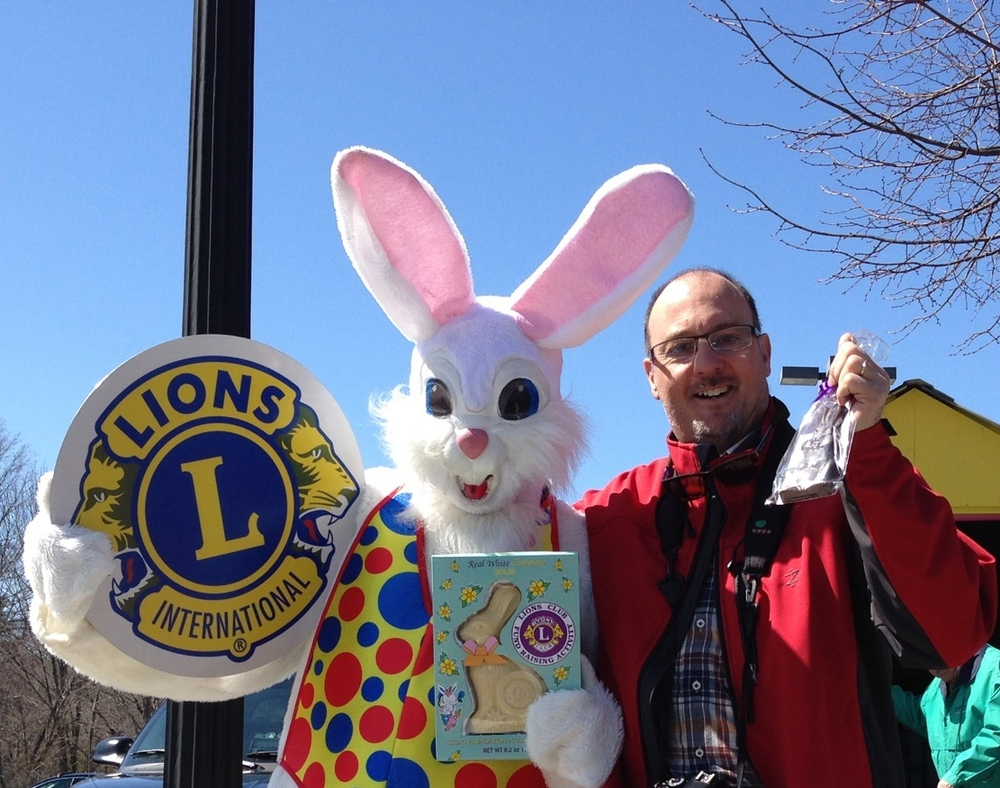 Photo by Gary Meyers. Schroon's Easter Bunny with another satisfied customer!