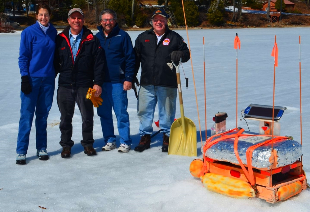 """Photo: Schroon Lions Club Members setting out the Star Wars like """"Ice-Out Machine""""."""