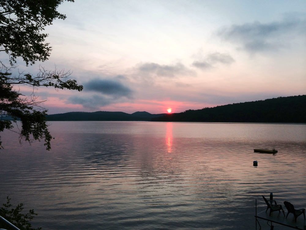 Sunrise. July, 2014. Looking towards the north-east side of Schroon Lake. Picture from the Schroon Laker Collection. Copyright 2014. All Rights Reserved.