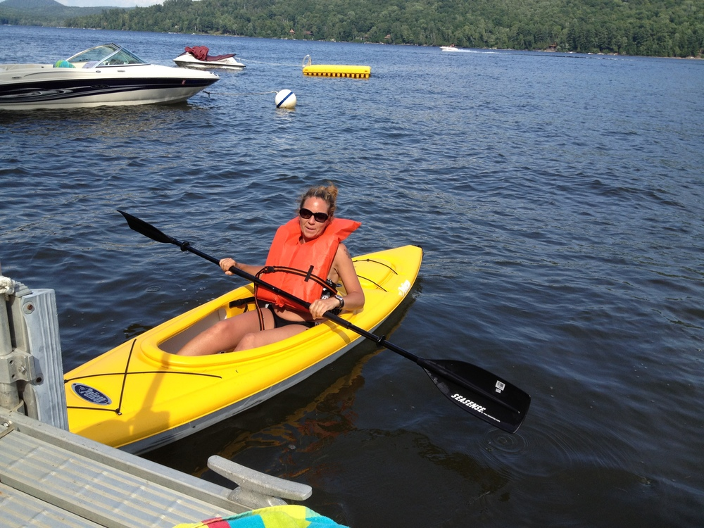 Schroon Lake Visitor Melissa Alonso taking a Pelican Kayak out for a spin! Always wear your lifevests. Photo: Schroon Laker Collection