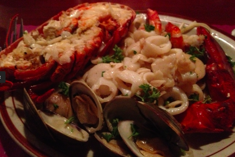 Drake's Zuppa Langosta is an overflowing plate consisting of half a good size lobster, clams, scallops, calamari and shrimp in a garlic and white wine sauce served over pasta.