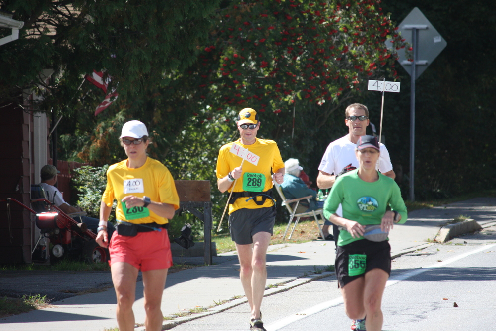 The 4 Hour Pace Bears with runners during  the 2013 Marathon. Schroon Laker Collection.