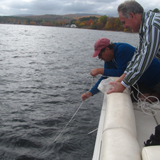 Picture shows Mike Ryan and Glen Repko retrieving water samples from Schroon lake on Wednesday. Pictures courtesy SLA.