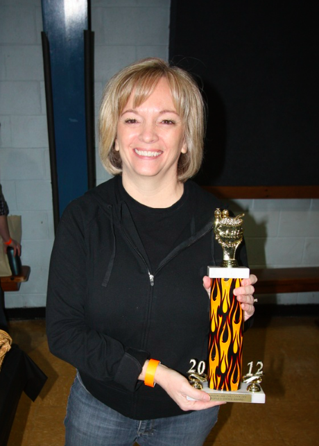 PEOPLE'S CHOICE CHILI WINNER: RUTHIE METTHE PETERSON WITH HER TROPHY IN 2012
