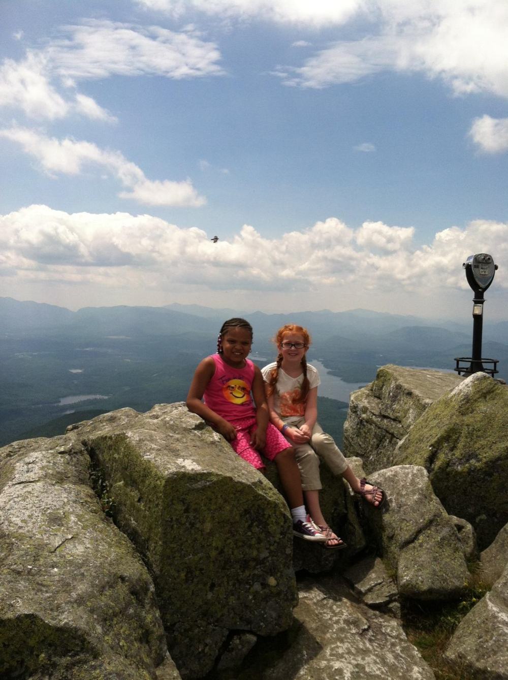 Photo Caption: Fresh Air child Desi and her host sister Lydia visiting Whiteface Mountain in Lake Placid last July during Desi's visit with the Moses family. Photo by: Donna Moses
