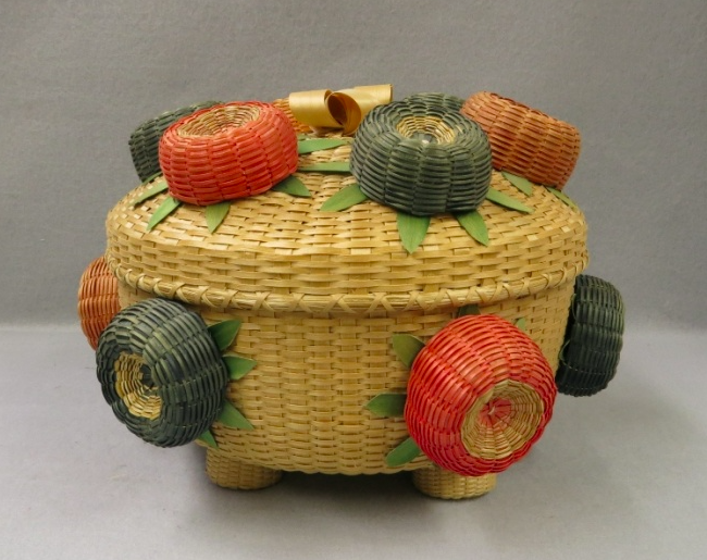 From The Adirondack Museum: Multicolored basket, with ash splint and sweetgrass, from the Akwesasne Museum