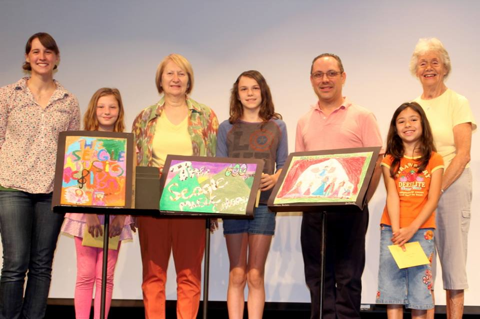 Photo Caption, From Left: Art Teacher Brie Livingston, Michaela Udes , Seagle Guild President Sharon Hieber, Lilliana Hurtade, General Director Tony Kostecki, Malena Gereau , Centennial Chairperson Lil Richardson.