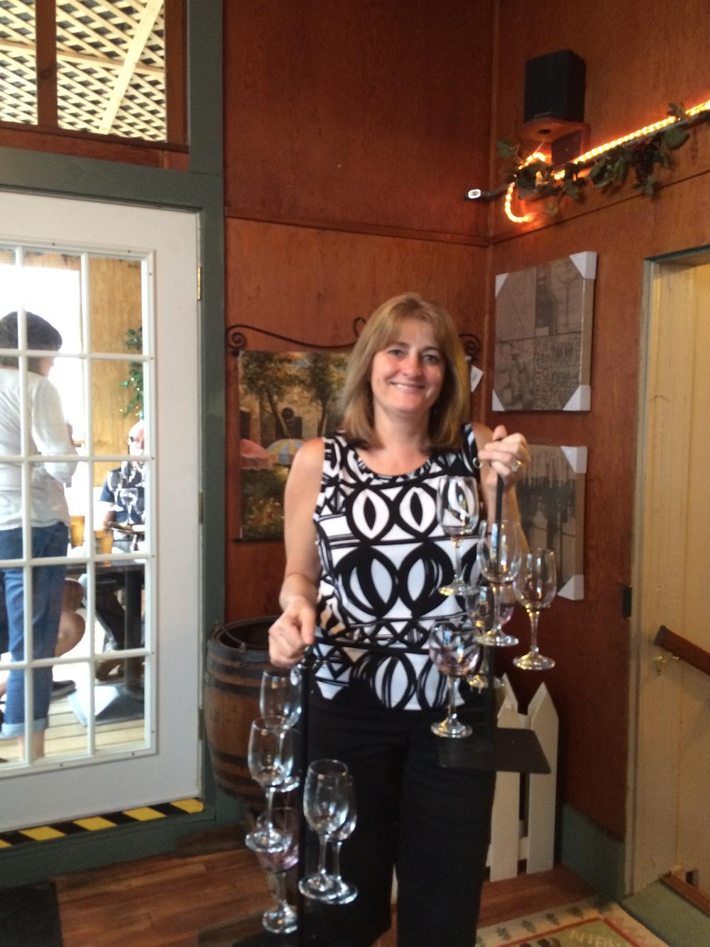 Patti Mehm, holding two (empty) wine flights