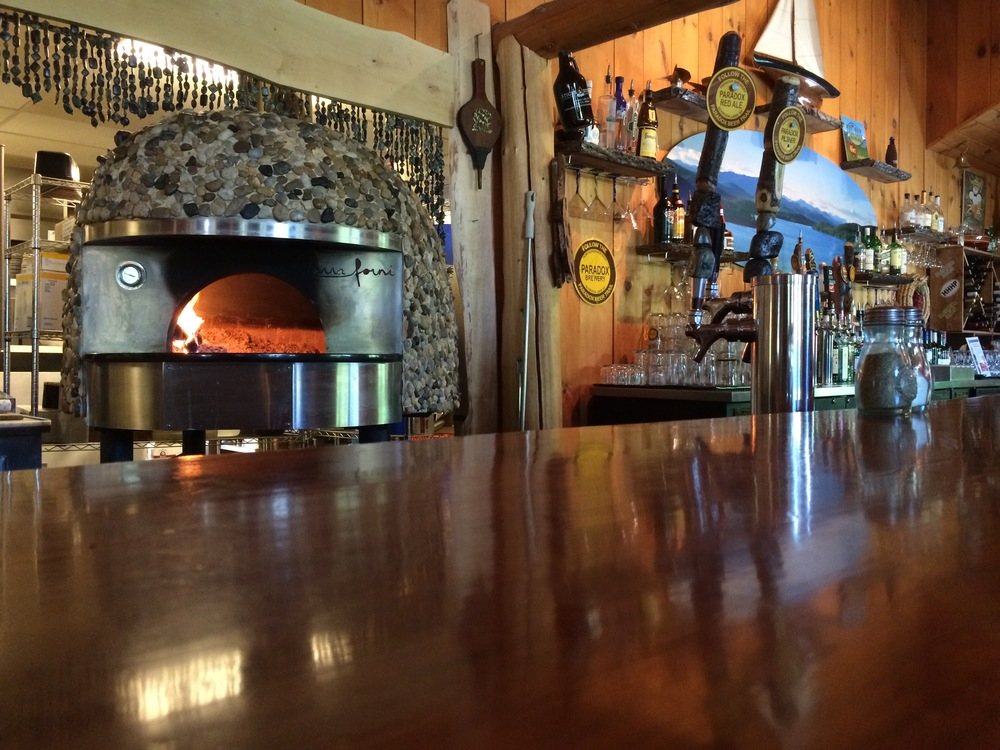 The wood burning pizza oven and bar at sticks & Stones