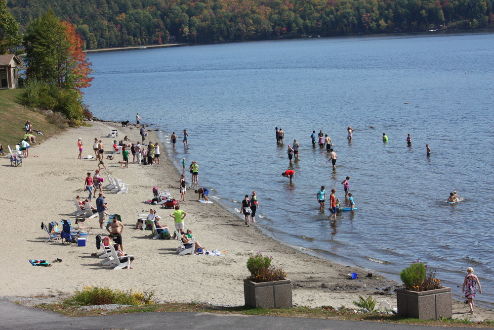 runners cooling their feet at the town beach after the 2014 race