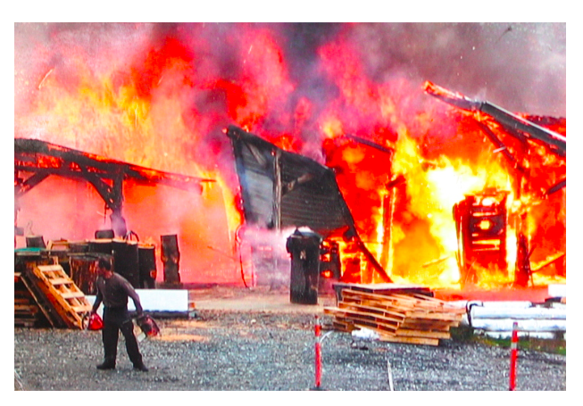 frank outside his studio as a blaze reduced it to ruble in 2003.
