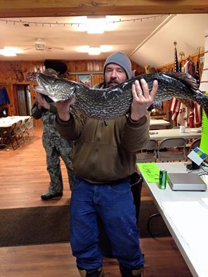 JARED GUESS WITH HIS WINNING NORTHERN PIKE. photo courtesy Schroon lake Fish and Game Club