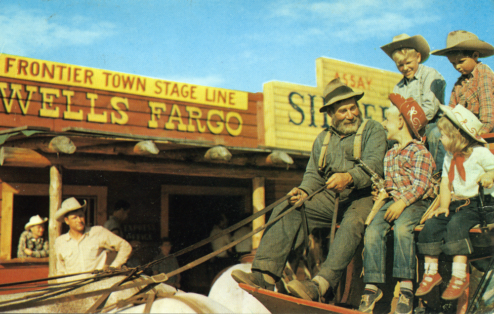 The good old days. Young cowboys and cowgirls taking a ride on the stagecoach.