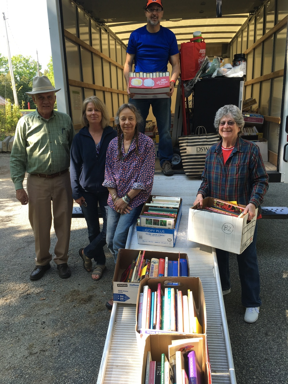 Volunteers unload thousands of books in the Spring.